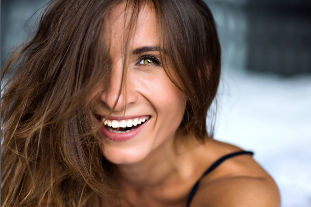 Woman smiling with porcelain veneers in Bangor ME | Maine Family Dental