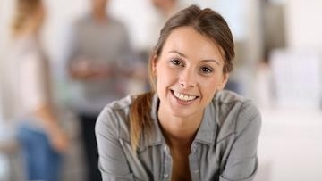 woman smiling | maine family dental practice